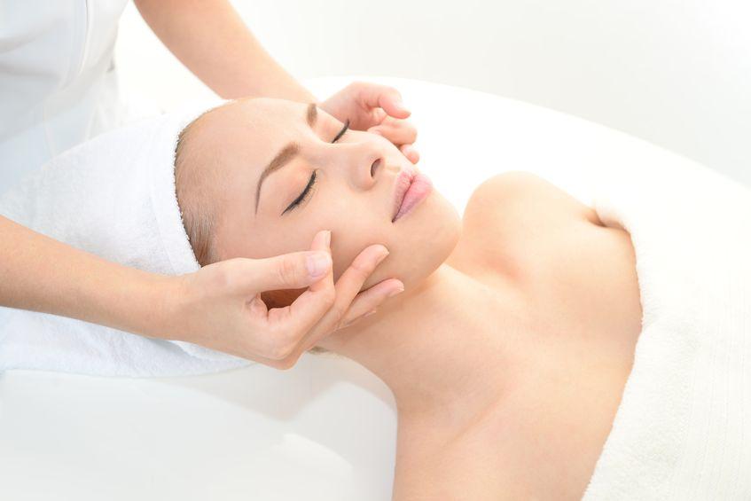 18475564 - pretty woman receiving facial massage